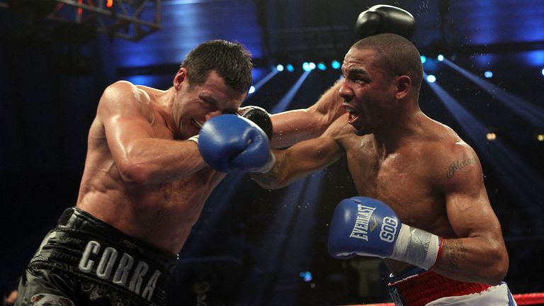 Andre Ward lands a right on Carl Froch of England during their WBA/WBC Super Middleweight Championship bout at Boardwalk Hall on December 17, 2011