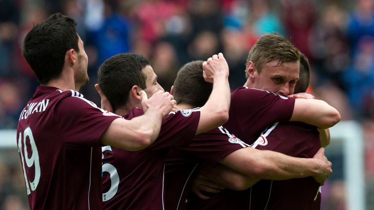 Kevin McHattie is mobbed by team-mates after doubling Hearts' lead against St Mirren