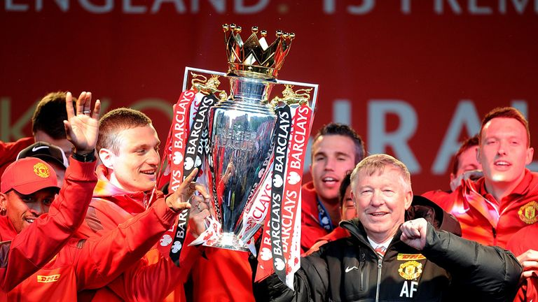 Manchester United players and manager Sir Alex Ferguson celebrate
