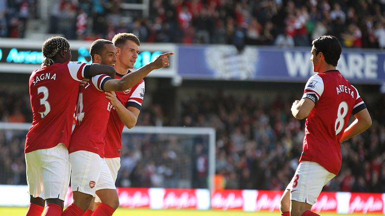 Theo Walcott: Celebrates Arsenal's very early winner