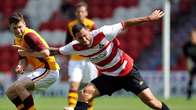 Iain Vigurs: Battles Doncaster's Billy Paynter for the ball