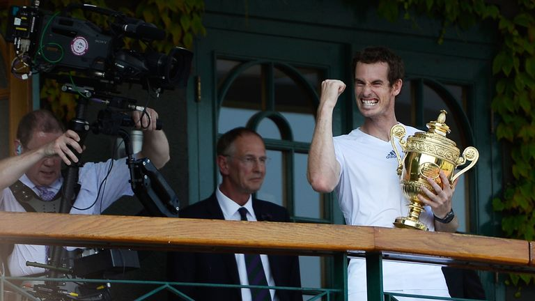 Andy Murray celebrates with the Wimbledon trophy