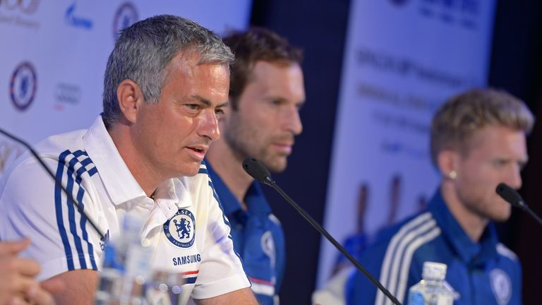 Chelsea football Manager Jose Mourinho (L) answers a question from the press next to players Petr Cech (C) and Andre Schurrle (R) during a press conference at a hotel in Bangkok on July 12, 2013.