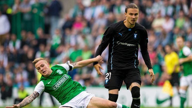 Hibs' Danny Handling battles with Malmo's Erik Jansson