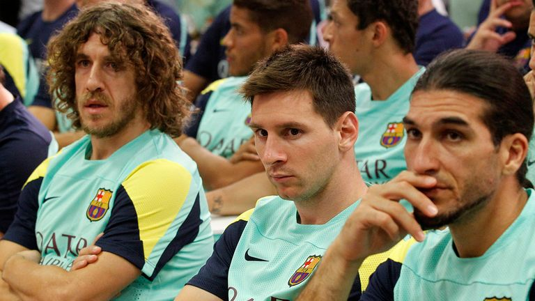 (FromL) Barcelona's captain Carles Puyol, Barcelona's Argentinian forward Lionel Messi and Barcelona's goalkeeper Jose Manuel Pinto attend a press conference given by Barcelona's President Sandro Rosell in Barcelona on July 19, 2013. Rosell confirmed during a news conference today that coach Tito Vilanova stepped down because he has suffered a relapse of cancer.  AFP PHOTO/ QUIQUE GARCIA        (Photo credit should read QUIQUE GARCIA/AFP/Getty Images)