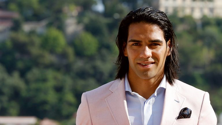 Colombian forward Radamel Falcao poses while holding his new jersey from French L1 Monaco football club after a press conference on July 9, 2013 in Monaco. Falcao, who was recruited by the club Monaco for around 60 million euros, said on July 9, 2013 he is aiming to help his new club become one of the best in Europe again. AFP PHOTO / VALERY HACHE        (Photo credit should read VALERY HACHE/AFP/Getty Images)