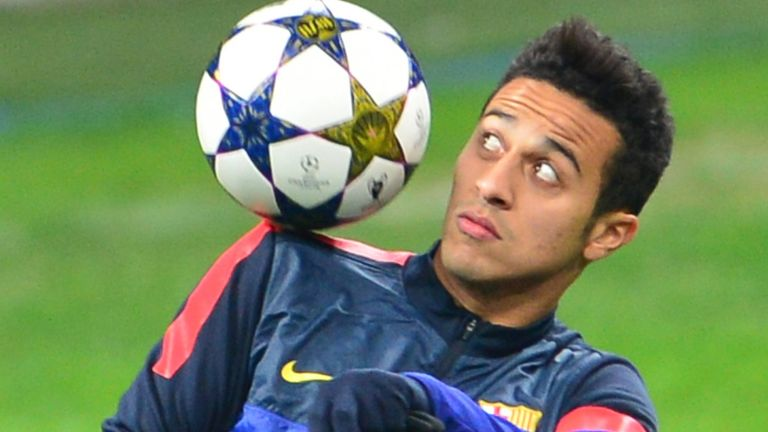 Barcelona's midfielder Thiago Alcantara controls a ball during a training session on the eve of an UEFA Champions League football match against AC Milan on February 19, 2013 at San Siro Stadium in Milan.  AFP PHOTO / GIUSEPPE CACACE        (Photo credit should read GIUSEPPE CACACE/AFP/Getty Images)