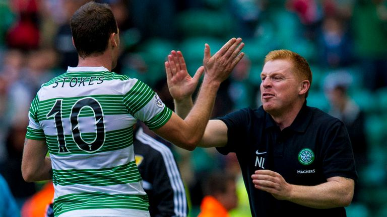 Celtic striker Anthony Stokes is congratulated by manager Neil Lennon after scoring his second goal