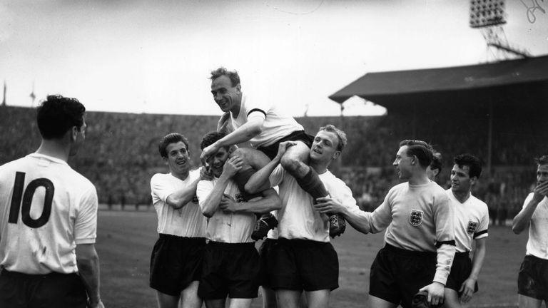 England and Wolverhampton Wanderers captain, Billy Wright, is carried aloft in triumph by his team mates following England's victory over Scotland at Wembley Stadium. It was also Wright's 100th international match for England.
