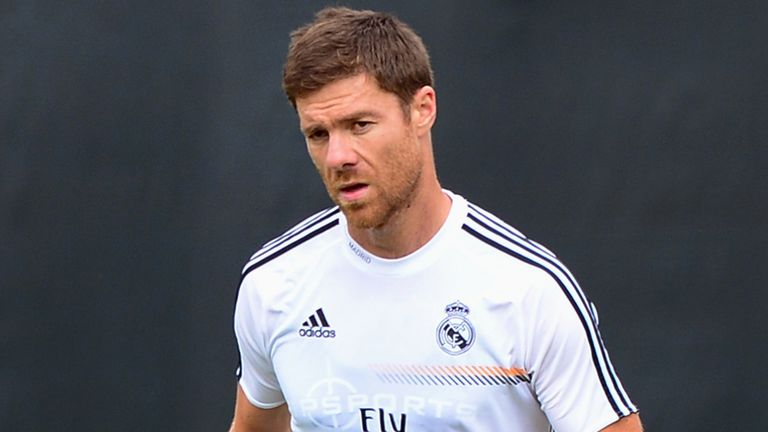 Real Madrid's Xabi Alonso warms up during a morning training session at UCLA on July 30, 2013 in Los Angeles, California. Real Madrid will play the Los Angeles Galaxy at Dodger Stadium on August 3 as part of a double header which also includes Juventus v Everton in the Guiness International Champions Cup. AFP PHOTO/Frederic J. BROWN        (Photo credit should read FREDERIC J. BROWN/AFP/Getty Images)