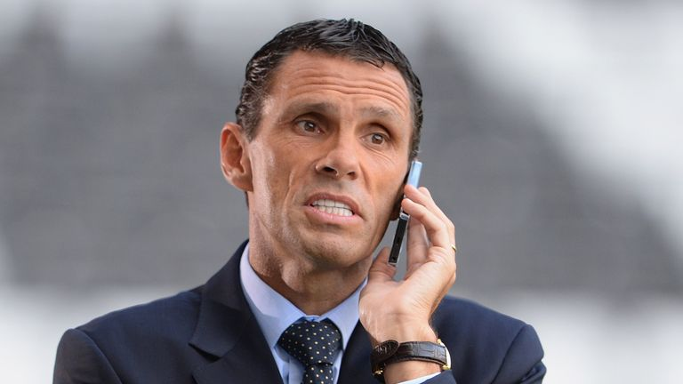 Gus Poyet looks on before the UEFA Europa League third round qualifying first leg match between Swansea City and Malmo at the Liberty Stadium on August 1, 2013 in Swansea, Wales.