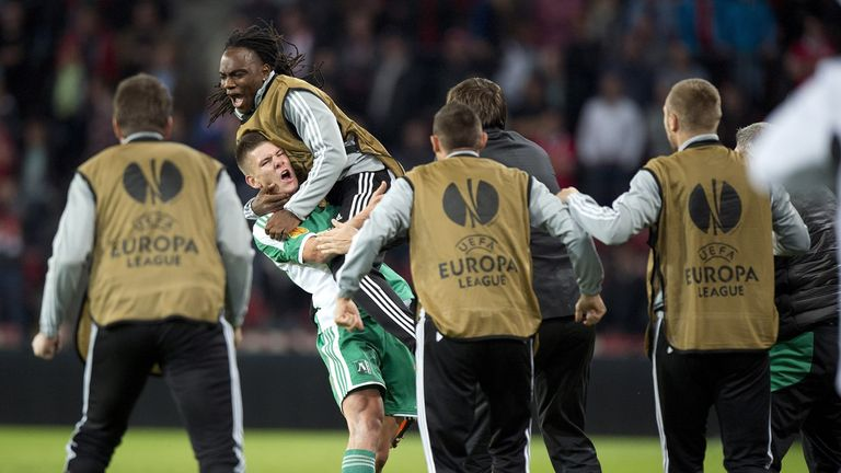 Roman Bezjak (2nd L) of PFK Ludogorets celebrates with his teammates after scoring during the UEFA Europa league football match PSV Eindhoven vs PFK Ludogorets in Eindhoven, on September 19, 2013.   AFP PHOTO / ANP / MARCEL VAN HOORN ***netherlands out ***        (Photo credit should read MARCEL VAN HOORN/AFP/Getty Images)