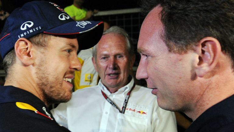 Sebastian Vettel and Christian Horner at Suzuka, as Helmut Marko looks on