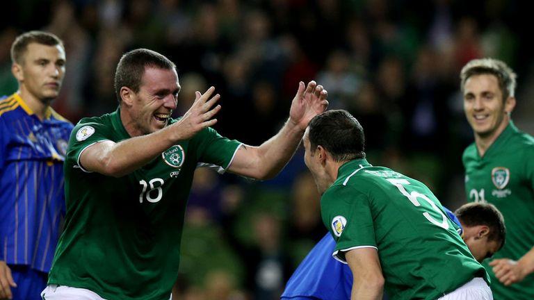 John O'Shea (r): Celebrates with Richard Dunne