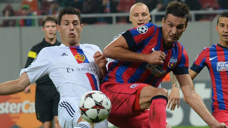 Fabian Schar (left) could be a cheaper option for Wenger