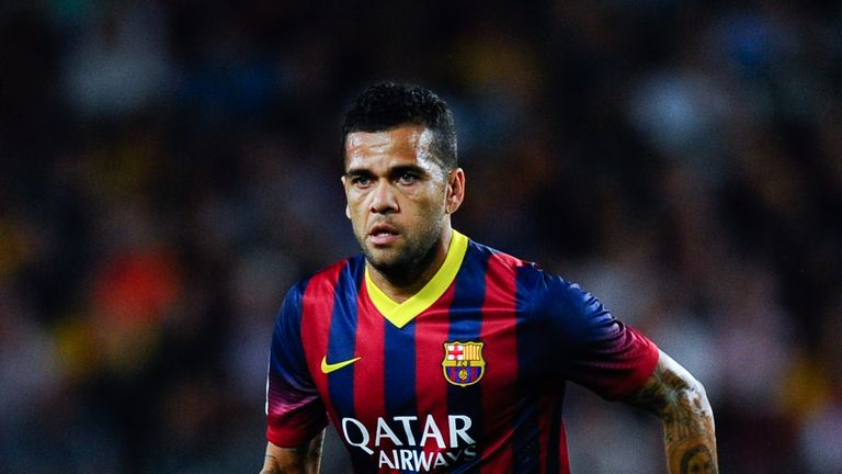 BARCELONA, SPAIN - SEPTEMBER 14:  Dani Alves of FC Barcelona runs with the ball during the La Liga match between FC Barcelona and Sevilla FC at Camp Nou on September 14, 2013 in Barcelona, Spain.  (Photo by David Ramos/Getty Images)
