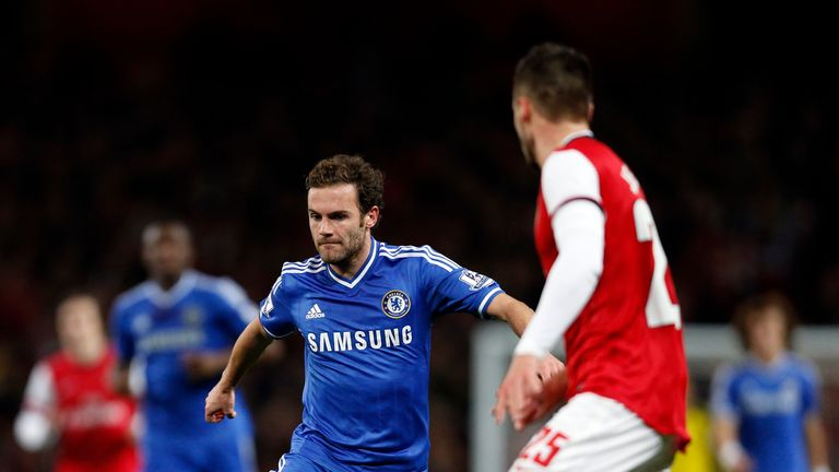 Chelsea's Spanish midfielder Juan Mata runs with the ball during the English League Cup fourth round football match between Arsenal and Chelsea at the Emirates Stadium in London on October 29, 2013. AFP PHOTO / ADRIAN DENNISnnRESTRICTED TO EDITORIAL USE. No use with unauthorized audio, video, data, fixture lists, club/league logos or live services. Online in-match use limited to 45 images, no video emulation. No use in betting, games or single club/league/player publications.        (Photo credit should read ADRIAN DENNIS/AFP/Getty Images)