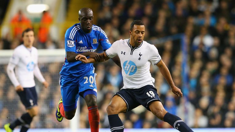 Yannick Sagbo of Hull City and Mousa Dembele of Spurs compete for the ball during the Premier League match at White Hart Lane.