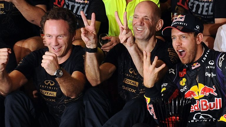 Adrian Newey (middle) celebrates with team principal Christian Horner (left) and Vettel (right)
