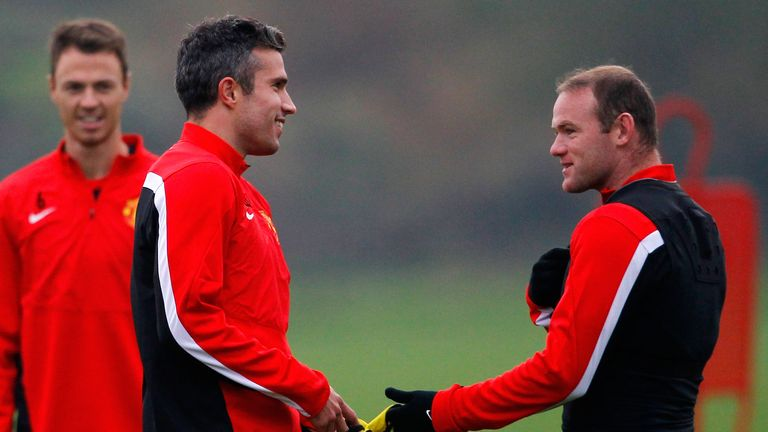 Wayne Rooney (R) and Robin van Persie of Manchester United talk during a training session ahead of their Champions League Group A match against Shakhtar Donetsk at their Carrington Training Complex on October 01, 2013.