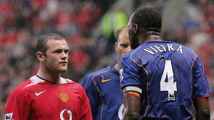 MANCHESTER, ENGLAND - OCTOBER 24: Wayne Rooney of Manchester United clashes with Patrick Vieira of Arsenal during the Barclays Premiership match between Manchester United and Arsenal at Old Trafford on October 24, 2004 in Manchester, England. (Photo by Chris Coleman/Manchester United via Getty Images) *** Local Caption *** Wayne Rooney;Patrick Vieira