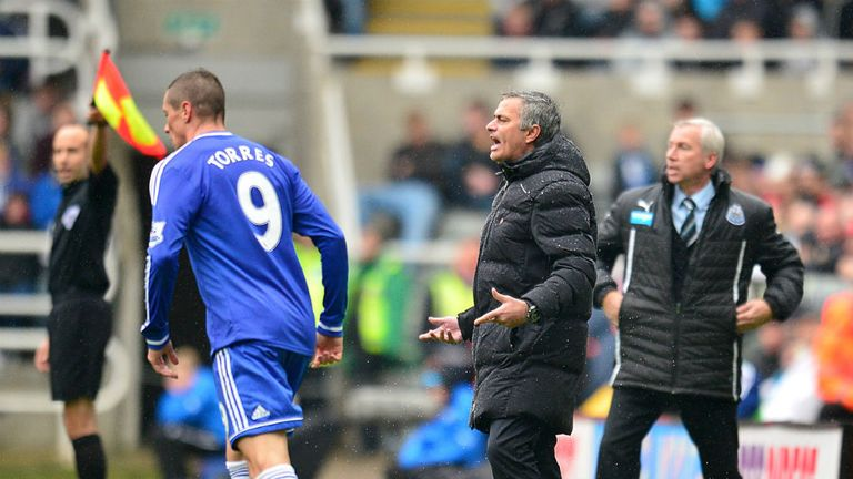 Chelsea manager Jose Mourinho shows his frustration on the touchline ahead of his player Fernando Torres