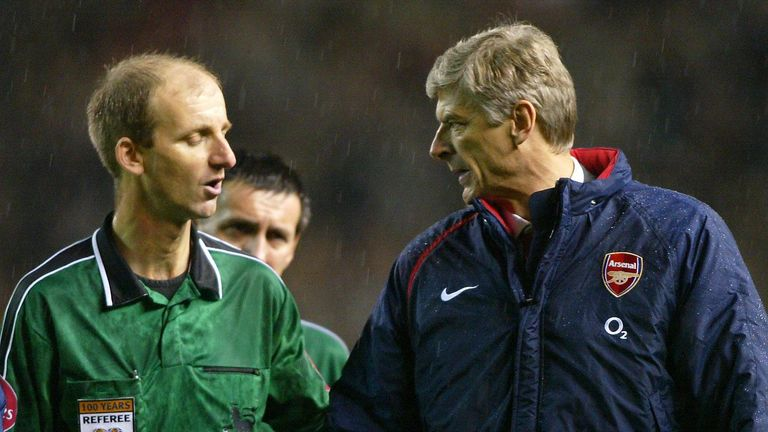 Arsenal manager Arsene Wenger (right) has a word with match referee Mike Riley after his team's defeat against Manchester United in the Barclays Premiership match at Old Trafford, Manchester.   THIS PICTURE CAN ONLY BE USED WITHIN THE CONTEXT OF AN EDITORIAL FEATURE. NO WEBSITE/INTERNET USE UNLESS SITE IS REGISTERED WITH FOOTBALL ASSOCIATION PREMIER LEAGUE.