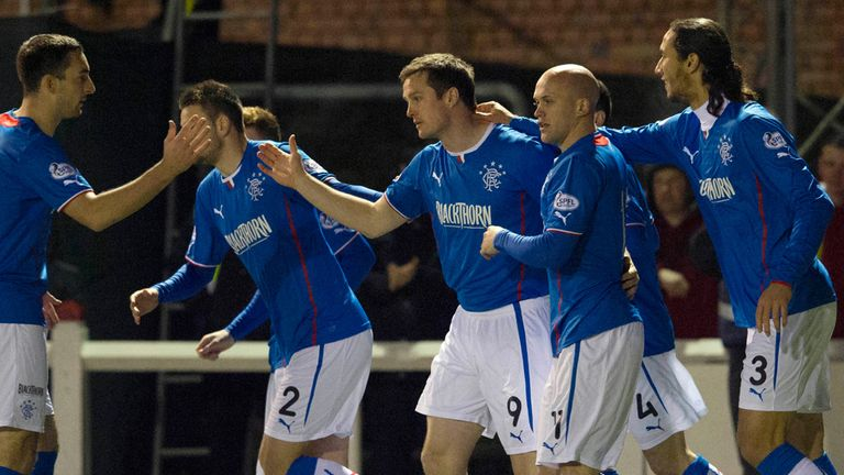 Jon Daly: Gets congratulations from his Rangers team-mates after opening scoring at Arbroath