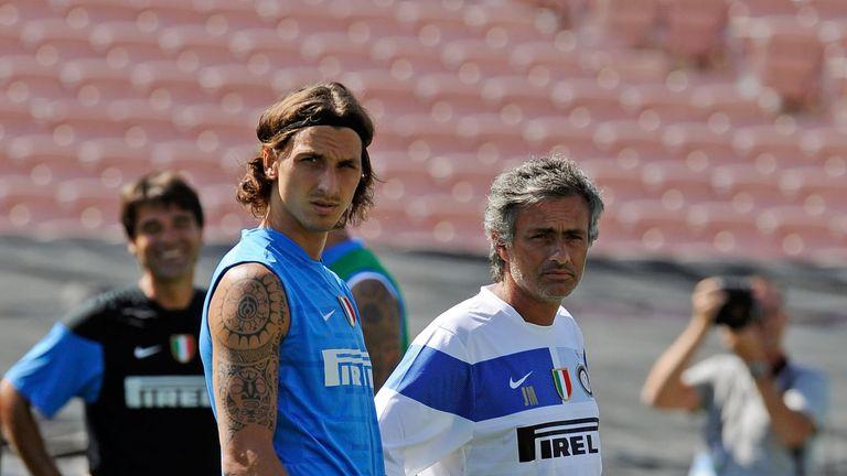 Zlatan Ibrahimovic (L) striker of Inter Milan and coach Jose Mourinho talk as they watch team practice at the Rose Bowl stadium