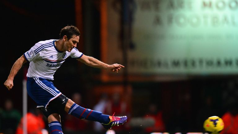 Frank Lampard of Chelsea scores the opening goal from the penalty spot during the Barclays Premier League match between West Ham United and Chelsea at Boleyn Ground on November 23, 2013
