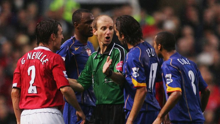 Mike Riley controversially awarded United a penalty as they ended Arsenal's 49-game unbeaten run in 2004