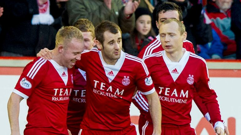 Nicky Low (L): Mobbed by his teammates after a stunning free-kick