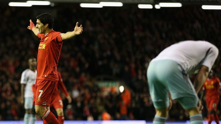 Luis Suarez: Celebrates after his shot deflected in off Joey O'Brien