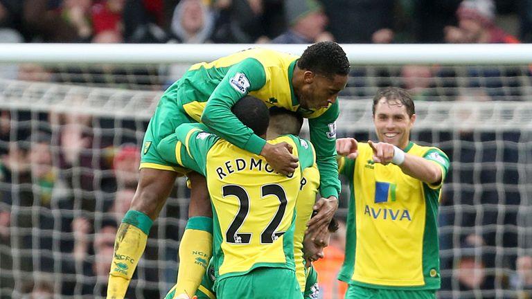 Gary Hooper: Buried beneath Norwich players celebrating his goal