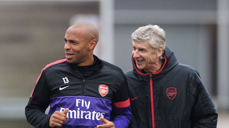 Arsenal manager Arsene Wenger with ex player Thierry Henry