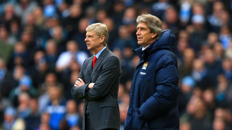 Arsene Wenger manager of Arsenal and Manuel Pellegrini manager of Manchester City look on during the Barclays Premier League match