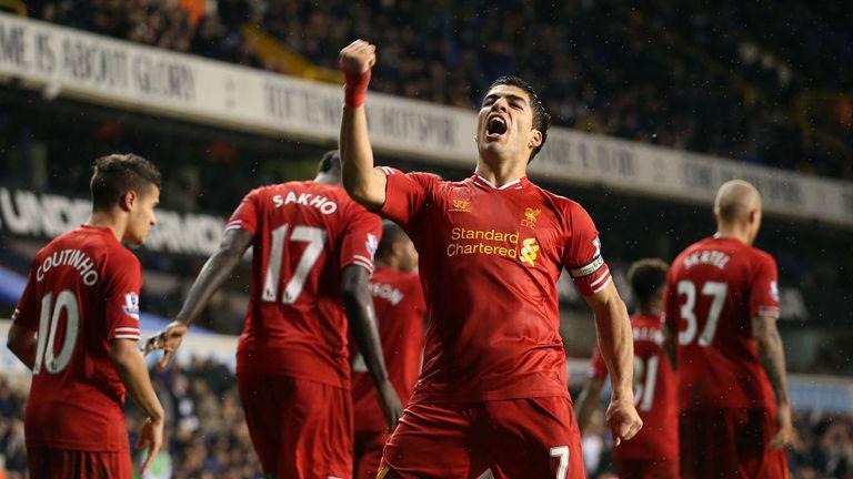 Liverpool's Luis Suarez celebrates scoring his sides' fourth goal during the Barclays Premier League match at White Hart Lane, London.