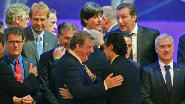 England's coach Roy Hodgson (L at centre) and Italy's coach Cesare Prandelli greet each other as the coaches of the national football teams taking part in