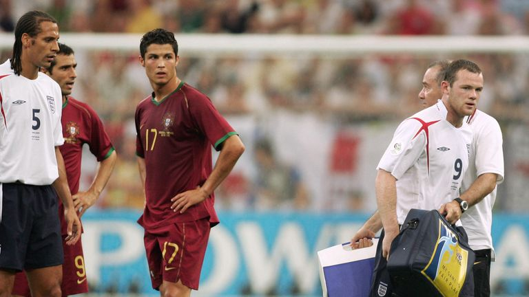 Ronaldo looks on as Manchester United team-mate Wayne Rooney is sent off during a World Cup game between England and Portugal July 2006