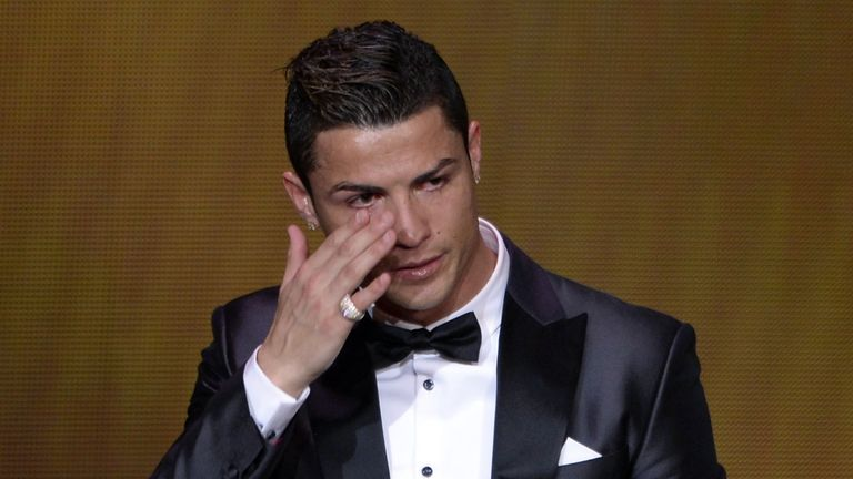 Real Madrid's Portuguese forward Cristiano Ronaldo cries after receiving the 2013 FIFA Ballon d'Or award for player of the year during the FIFA Ballon d'Or