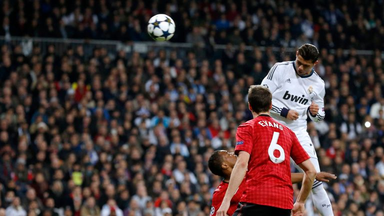 Real Madrid's Portuguese forward Cristiano Ronaldo (top) heads the ball to score during the UEFA Champions League match against Manchester United