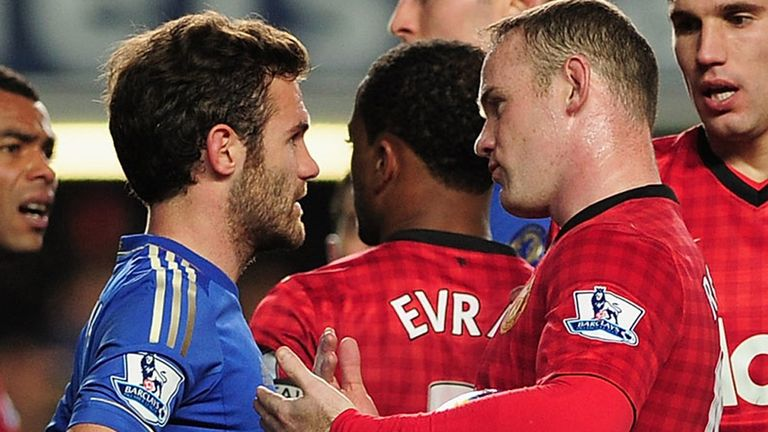LONDON, ENGLAND - OCTOBER 28: Juan Mata of Chelsea talks to Wayne Rooney of Manchester United as referee Mark Clattenburg looks on during the Barclays Prem