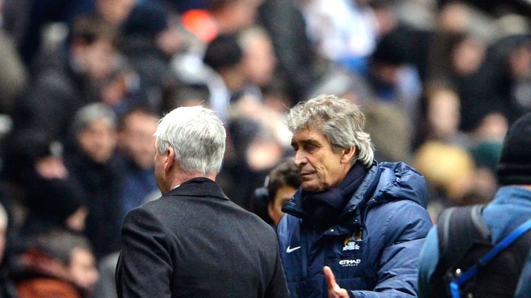 NEWCASTLE UPON TYNE, ENGLAND - JANUARY 12:  (L-R) Alan Pardew the Newcastle manager shakes hands with Manuel Pellegrini the Manchester City manager