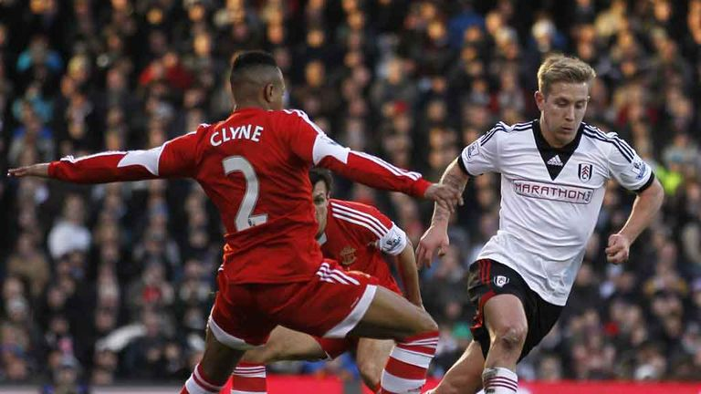 Lewis Holtby vies with Southampton defender Nathaniel Clyne