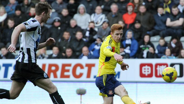 - Jack Colback of Sunderland shoots and scores his teams third goal as Michael Williamson of Newcastle closes in