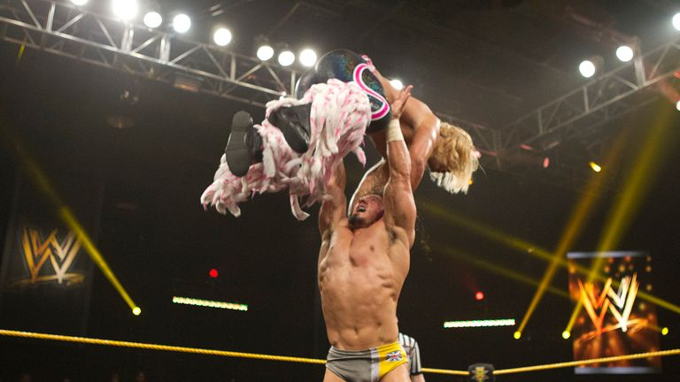 Neville, pictured above wrestling Tyler Breeze, won the NXT Title from Bo Dallas at arRIVAL