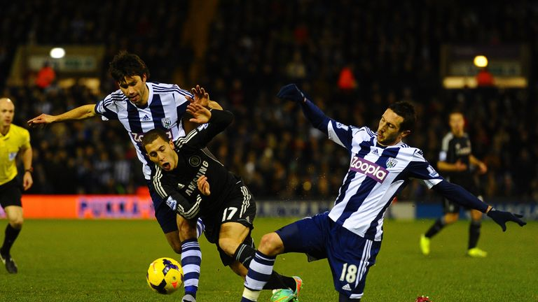 Eden Hazard of Chelsea is tackled by Morgan Amalfitano of West Brom