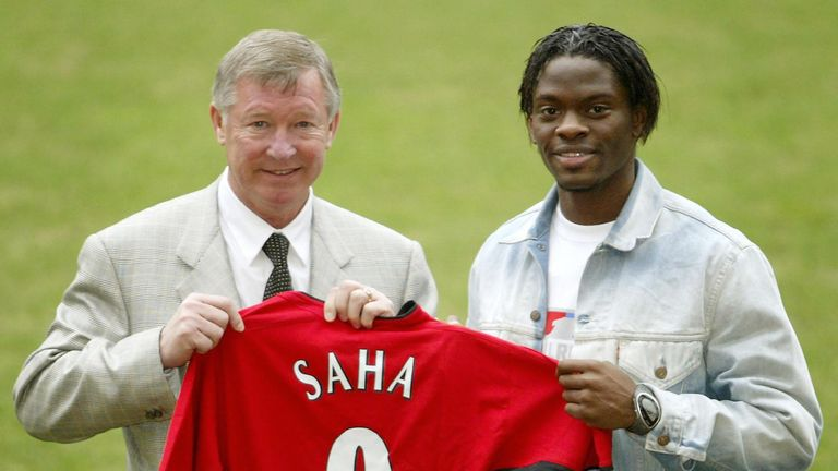 Manchester United new signing Louis Saha with manager Sir Alex Ferguson, shows off his new shirt at a press call at Old Trafford, Manchester. The deal was