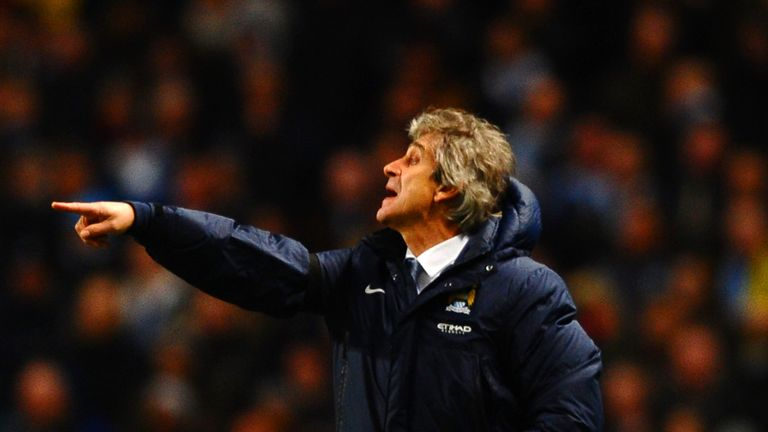 MANCHESTER, ENGLAND - FEBRUARY 03:  Manuel Pellegrini manager of Manchester City gives instructions during the Barclays Premier League match between Manche