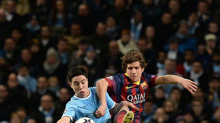 Manchester City's Samir Nasri (left) and Barcelona's Carnicer Sergi Roberto battle for the ball